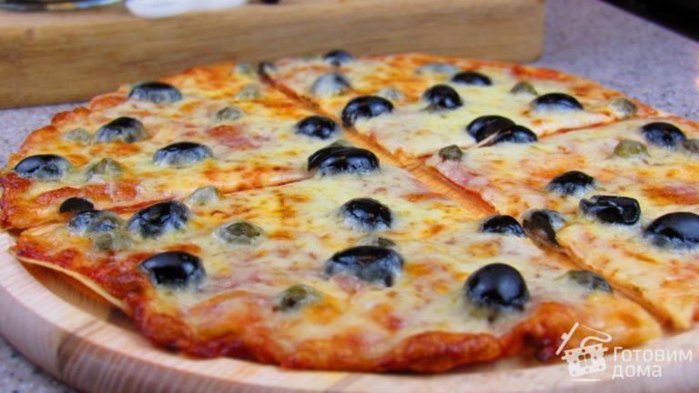 Экспресс-рецепт – тонкая и очень аппетитная пицца из лаваша + фото